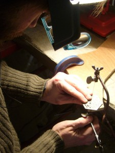 Hand piercing a stainless steel concertina-style bell push